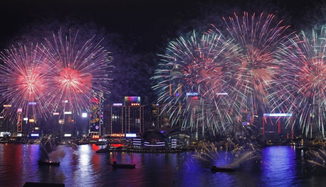 Fireworks explode over the Victoria Harbour to celebrate the Chinese Lunar New Year in Hong Kong Tuesday, Jan. 24, 2012. (AP Photo/Vincent Yu)
